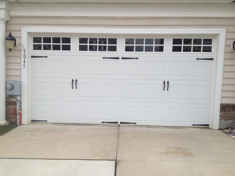 Clopay Coachman Collection carriage house garage door Design 11 with REC13 windows