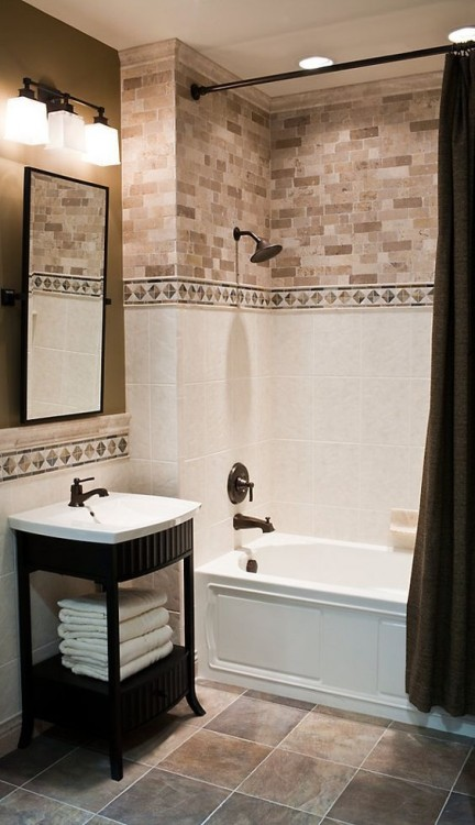 Elegant bathroom with white marble tile and antique mirror accents