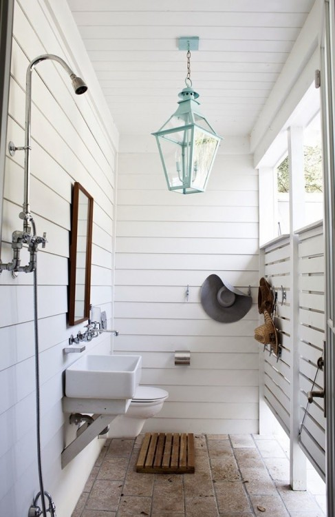 While a simple garden hose hanging from a tree can technically pass as an outdoor shower, why not get inspired by these luxurious upgrades to create a