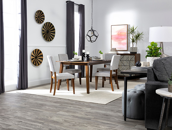 If you have wood floors, make sure to place a rug where wood furniture sits, such as the dining room table