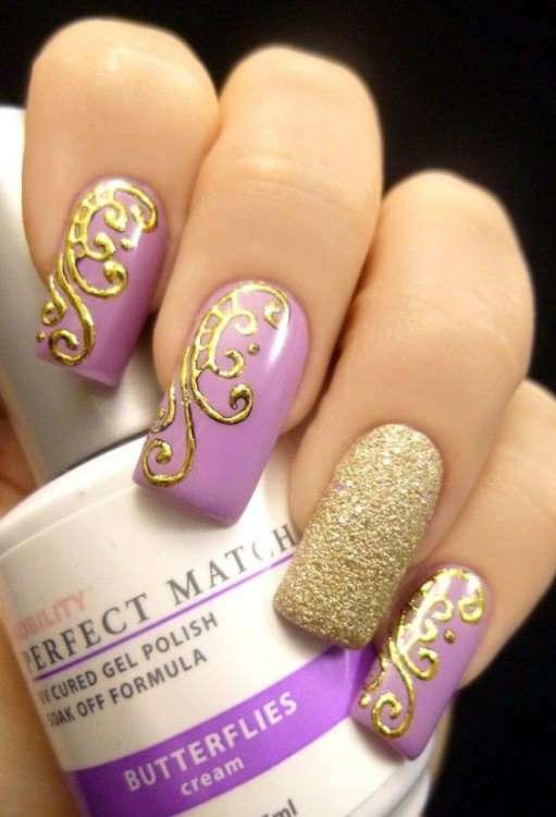 A perfect example of an ombre gel nail design using purple shades looks  incredibly beautiful